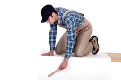 Male painter kneeling Stock Photography