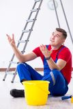 The male painter preparing for painting job at construction site Stock Photo