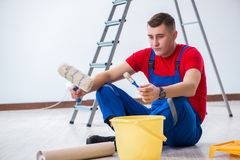 The male painter preparing for painting job at construction site Stock Photos