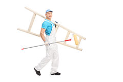 Male painter walking with paint roller and a ladder Royalty Free Stock Photo