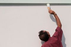 Male painting the wall. Royalty Free Stock Image