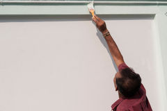 Male painting the wall. Stock Image