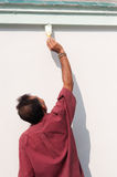 Male painting the wall. Royalty Free Stock Photos