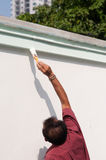 Male painting the wall. Stock Photo