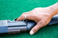 Male palm laying over the air gun Stock Image