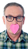 Male with paper heart over his mouth Royalty Free Stock Photo
