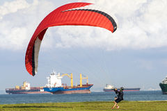 Male paraglider get ready to take off paragliding. Stock Photography