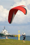 Male paraglider get ready to take off paragliding. royalty free stock image