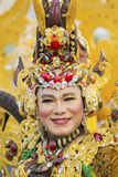 Male participant wearing gold costume. JEMBER - Indonesia. May 21, 2018: Male participant wearing gold costume on parade in Jember Festival Carnaval Royalty Free Stock Photos
