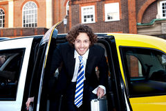Male passanger getting out of a taxi cab Stock Image