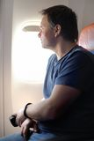 Male passenger in the airplane Stock Images