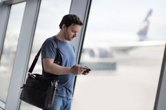 Male passenger at the airport with airplane on background Stock Photo