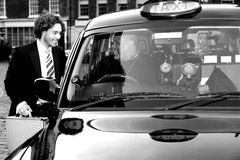 Male passenger communicating with taxi driver Royalty Free Stock Image