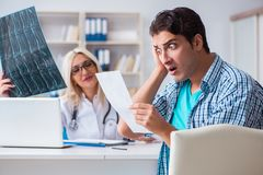 The male patient angry at expensive healthcare bill. Male patient angry at expensive healthcare bill stock images
