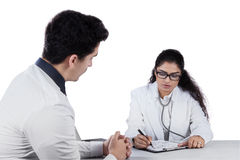 Male patient consulting with personal doctor Royalty Free Stock Photo