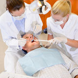 Male patient at dental checkup Stock Photos