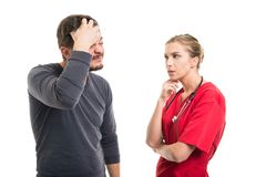 Male patient doing face palm next to lady doctor. Isolated on white background Royalty Free Stock Photos
