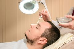 Face mask for man in beauty clinic stock photography