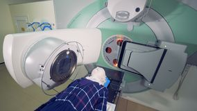 Male patient is going through radiotherapy