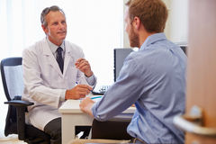 Male Patient Having Consultation With Doctor In Office Royalty Free Stock Photography