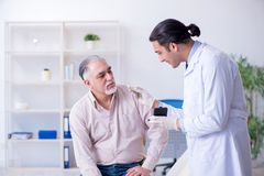 Male patient with hearing problem visiting doctor otorhinolaryng. Ologist stock photography