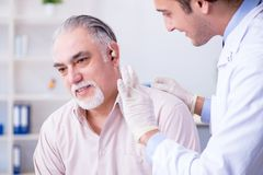 Male patient with hearing problem visiting doctor otorhinolaryng. Ologist stock photos