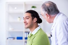 Male patient with hearing problem visiting doctor otorhinolaryng. Ologist stock image