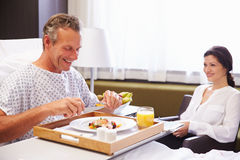 Male Patient In Hospital Bed Eating Meal From Tray Royalty Free Stock Photos