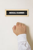 Male patient knocking on Medical Examiner door. For a medical exam stock photos
