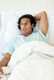 Male patient lying on a hospital bed Royalty Free Stock Images