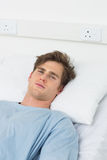 Male patient lying in hospital bed Stock Images