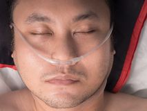 Male patient with oxygen tube. Closeup of male patient with oxygen tube stock photos
