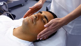 Male patient receiving massage from doctor stock footage