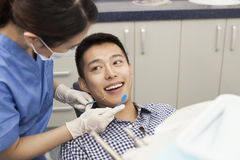 Male Patient Receiving Treatment In Clinic Royalty Free Stock Photo