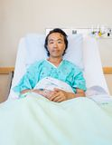 Male Patient Reclining On Bed In Hospital Royalty Free Stock Photos