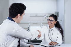 Male patient shaking hands with doctor Royalty Free Stock Photos