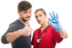 Male patient showing like and female doctor holding pill royalty free stock photo