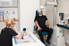 Patient in optometrist office for eye examination Royalty Free Stock Photo