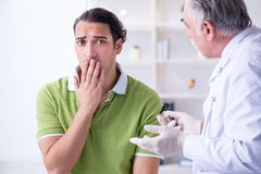 Male patient visiting doctor otolaryngologist. The male patient visiting doctor otolaryngologist stock photography