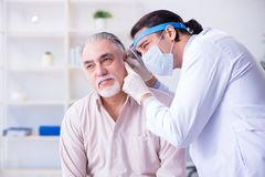 Male patient visiting doctor otolaryngologist. The male patient visiting doctor otolaryngologist stock image