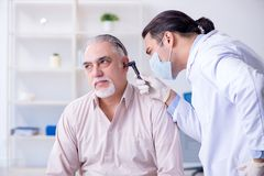 Male patient visiting doctor otolaryngologist. The male patient visiting doctor otolaryngologist stock images