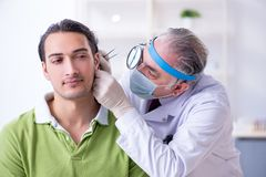Male patient visiting doctor otolaryngologist. The male patient visiting doctor otolaryngologist royalty free stock image