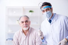 The male patient visiting doctor otolaryngologist. Male patient visiting doctor otolaryngologist royalty free stock images
