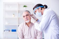 The male patient visiting doctor otolaryngologist. Male patient visiting doctor otolaryngologist royalty free stock photography
