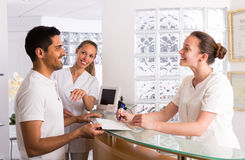 Male patient visiting medical clinic. Smiling european men patient visiting medical clinic Stock Photo