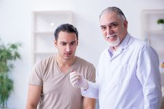 Male patient visitng doctor for shot inoculation. The male patient visitng doctor for shot inoculation royalty free stock image