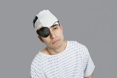 Male patient wearing an eye patch suffering from head injury royalty free stock image