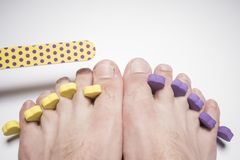 Male pedicure and nail file isolated on white Royalty Free Stock Images