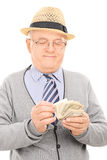 Male pensioner counting money Stock Photography