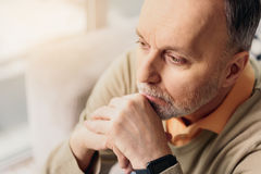 Male pensioner thinking seriously about something Stock Image